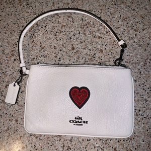 Coach white with red heart appliqué